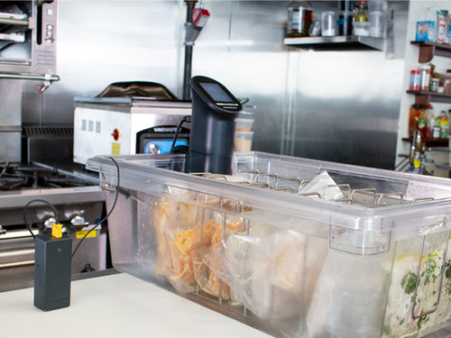 VacMaster SV5 Sous Vide Immersion Circulator with SOUS device in commercial kitchen cooking a full batch of sous vide chicken