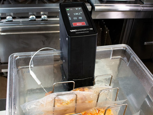 VacMaster SV10 Immersion Sous Vide Circulator with Chef and sous vide chicken in water bath