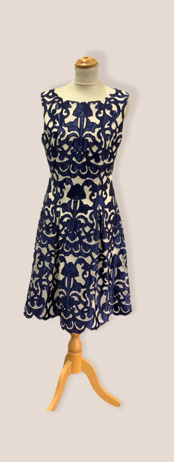Tia sleevless A line dress 78365 7432  gorgeous sleeveless dress with sheer overlay in navy and ivory. Lovely for a wedding, Christening or any special occasion.