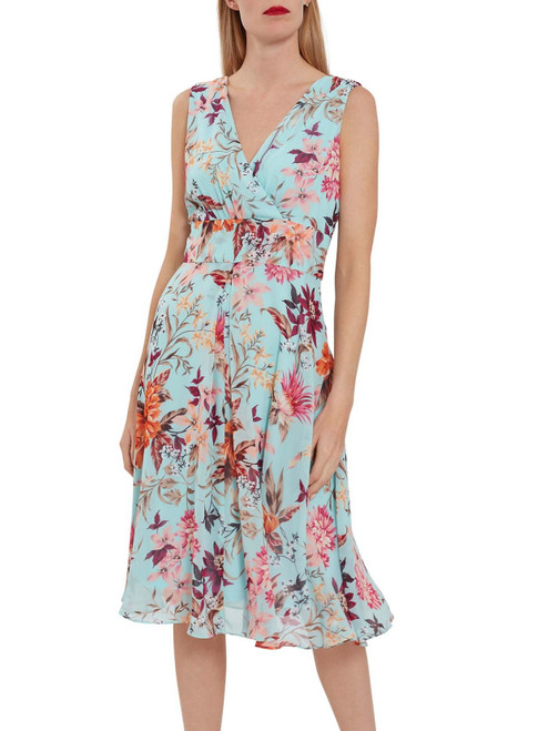 Gina Bacconi floral coral turqoise chiffon dress SBZ5539. the dress features a gorgeous floral chiffon overlay which moves beautifully as you walk. The dress is fully lined and fastens using a concealed under arm zip.Embrace the sun this summer in this fabulous floral piece. its a fit and flare style.