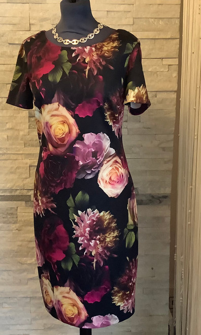 Frank Lyman flower print dress (193275)  A classic shift dress with a modern edge. Black with digital floral print and a rose gold exposed zip fastening at the back. Can be dressed up with heels or for a daytime look pair with boots and a long cardigan.