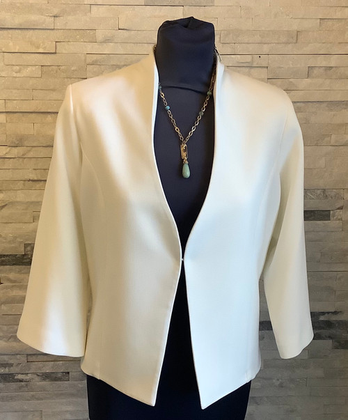 Libra jacket (LJ896)  Lovely ivory short jacket with 3/4 sleeves and scallop neckline. Astaple to have in your wardrobe to finish off an outfit. pair it with a dress or smart trousers and a cami for easy glamour.