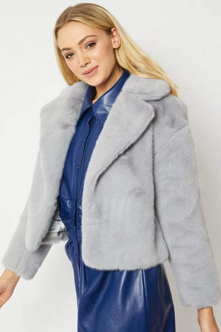 Faux Fur Cropped Coat  15% Acrylic  85% Modacrylic  Lining - 100% Viscose  One size  Comfortably fits size 8-14 depending on fit Jayley cropped faux fur jacket FMJ43A-03 On-trend style and warmth, two of the key features of this faux fur cropped jacket, make it a timeless piece easy to wear all year round.