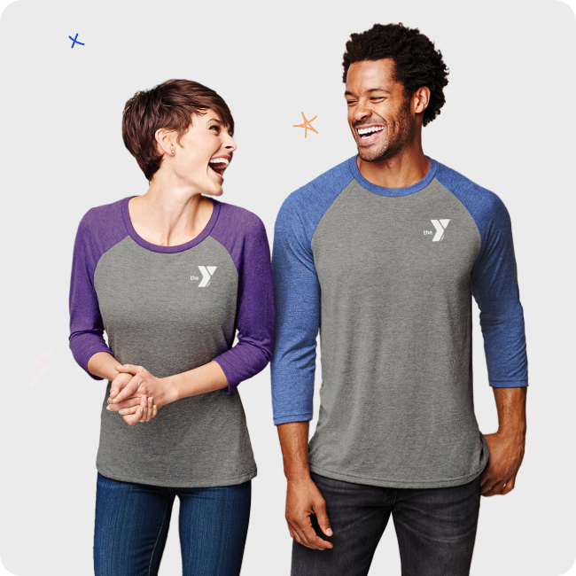couple wearing YMCA shirts and laughing