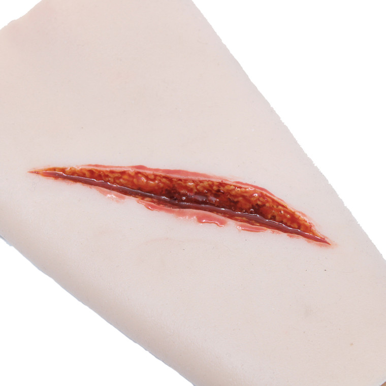 TraumaWear - a wearable & repeat use solution for rapid moulage. This one is simulating a Sharp Laceration wound and is simply pulled-on the forearm. Add Stage Blood to your syringe for simulated bleeding. It is available in 11 different colours.