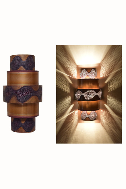 Day and Night View of the Burned Ziggurat Wall Sconce.  All the burned copper ziggurat sconces receive burned copper.  You may select the contrasting or coordinating solid metal bands to create the look that you desire.