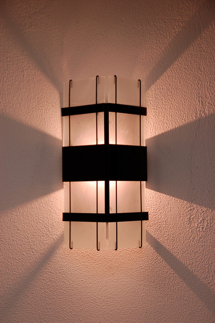 Night view of our popular Floating Glass wall sconce.  Shown here with frosted glass for a soft contemporary look.