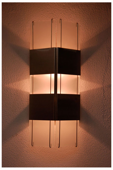 Evening view of this dynamic wall sconce.