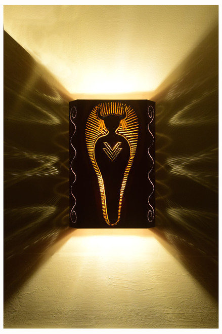 Medicine Man wall light shown at night.  Clear bulbs, LED or incandescent, provide this wonderful shadow effect on your wall.