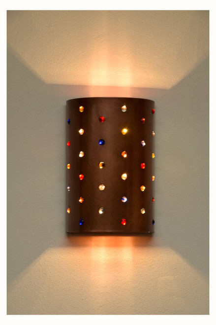 The solid copper in this wall light sheds a warm glow throughout your space.