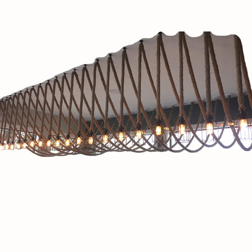 This fun rope light application is even more dramatic when used as multiple bare Edison bulb hanging fixtures.