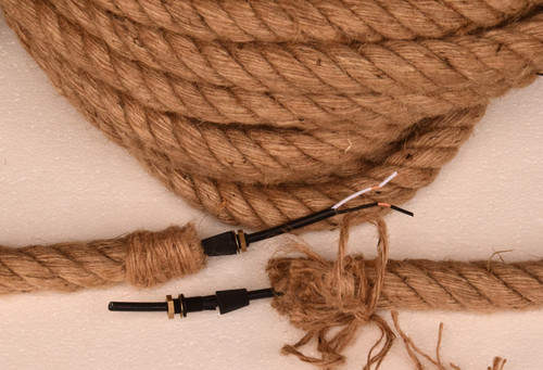 "18/2 electrical cord covered with 1"" diameter jute rope.  Shipped with two sets of grippers and rope strands to tie off ends."