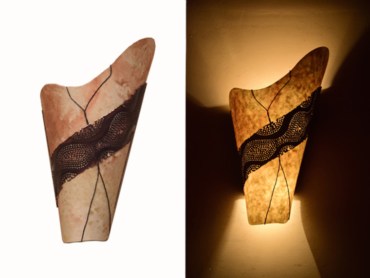 Day and night view of the same wall light.  Nomex, the diffuser shown here, is flexible, water resistant, fire resistant and translucent.