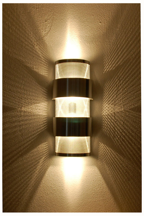 This photo shows the great light display that this contemporary or transitional wall light provides when combined with clear light bulbs.  Two bulbs are required in each fixture for uniform up and down lighting.