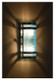 Stainless steel wall sconce with aqua moire pattern diffuser shown at night