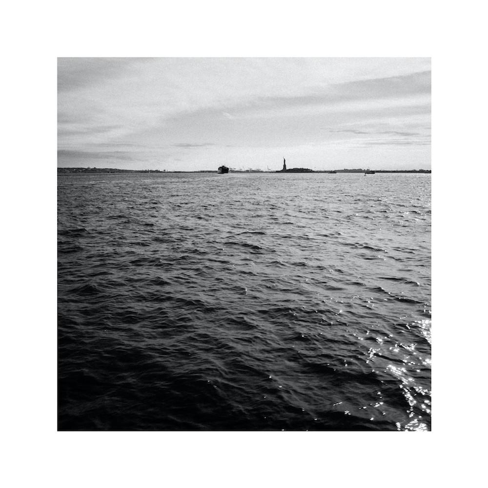Staten Island Ferry Passes Statue of Liberty by Joshua Wattles