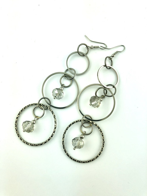 Silver rings and crystals long earrings
