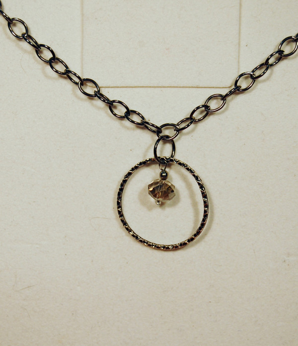 Silver circle with crystal drop necklace