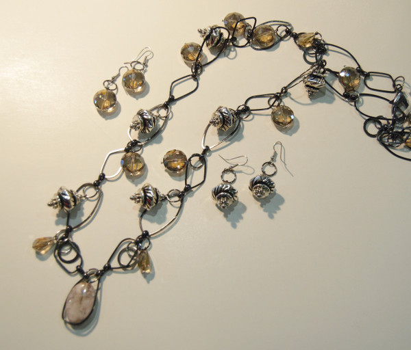 Abstract gun metal chain with silver bobbles and cream hued crystal drops