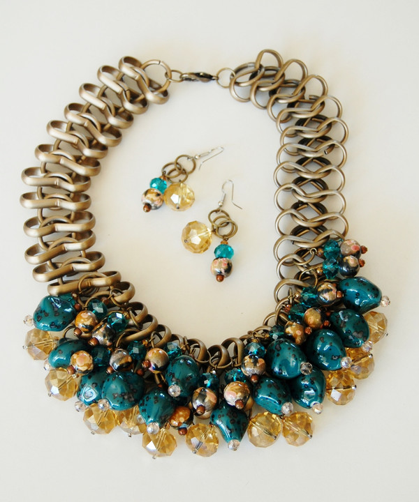 Turquoise and Crystals with Stones set off an Antique Gold Collar Chain
