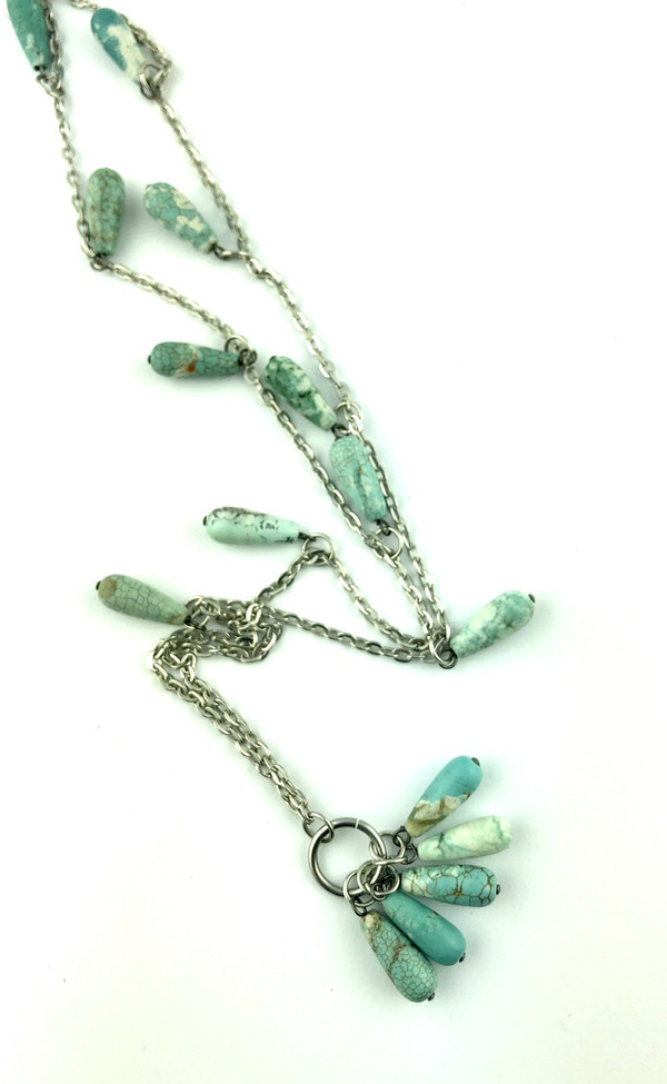 Turquoise Beads on a Long Silver necklace