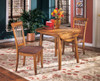 Larson Round Dining Table shown with Optional Dining Chairs