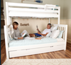 Crystal White Twin over Queen Bunk Bed shown with Optional Twin XL Storage Trundle Adult on Bed Room