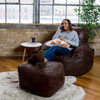 """Big Joe Nestle Vegan Leather Small Bean Bag Ottoman with Adult shown with Optional Chair Espresso Room (Adult is 5'5"""" tall)"""