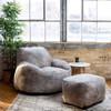 Big Joe Nestle Vegan Leather Small Bean Bag Ottoman shown with Optional Chair Cement Room