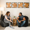"""SmartMax Big Joe Milano Bean Bag Chair x2 with 2 Adults Black Room (Adult on Left is 5'4"""" tall, Adult on Right is 5'8"""" tall)"""