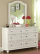 Daphne White Girls Dresser with matching mirror in room