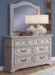Brylee 7 Drawer Dresser shown with Optional Arched Mirror Room