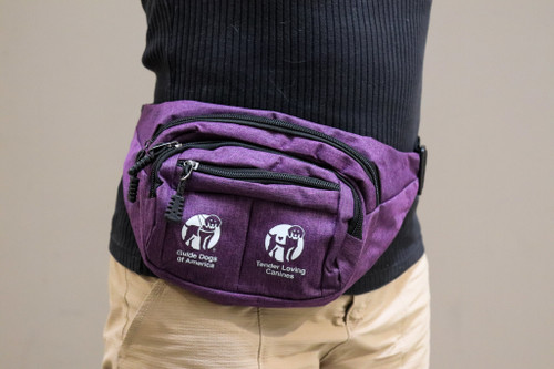 A person wearing a Purple fanny pack with the GDA | TLC logo.