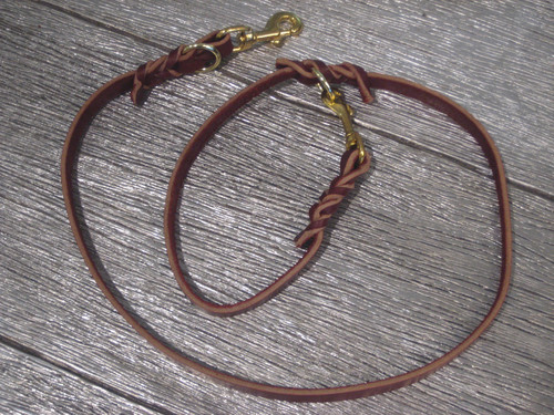 Brown Leather leash that is braided near the handle.