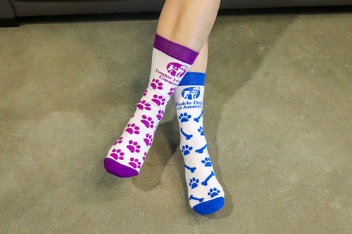 Full color woven 3/4 length crew sock. One sock GDA blue with logo, dog bones and pawprints. The other sock TLC purple with logo and pawprints.