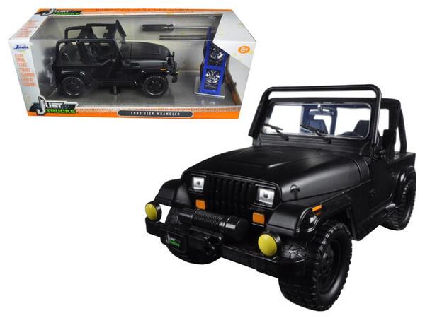 "1992 Jeep Wrangler ""Just Trucks"" with Extra Wheels Matt Black 1/24 Diecast Model Car by Jada 98020"