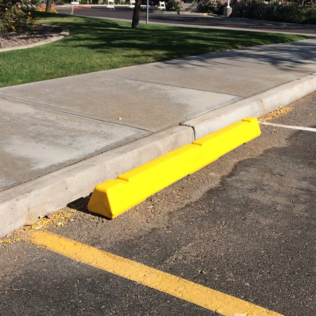 Yellow plastic parking block