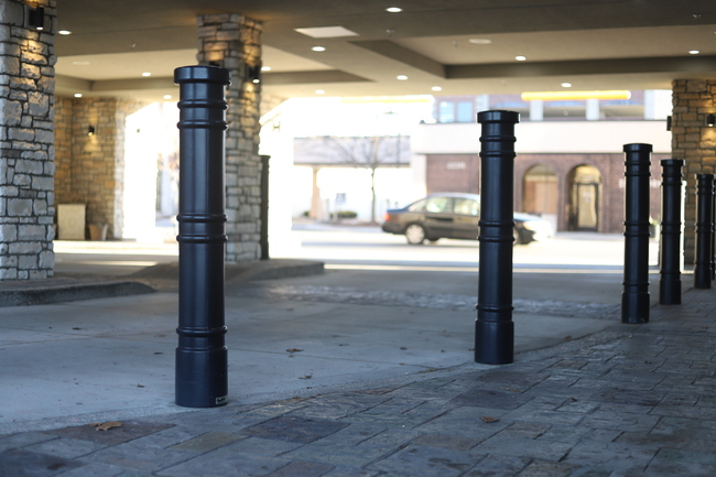 "6"" Black Metro Decorative Bollard Covers lining a drive way"