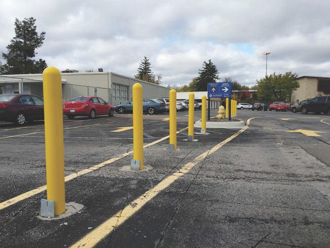 Removable Locking Bollard with Yellow Bollard Covers