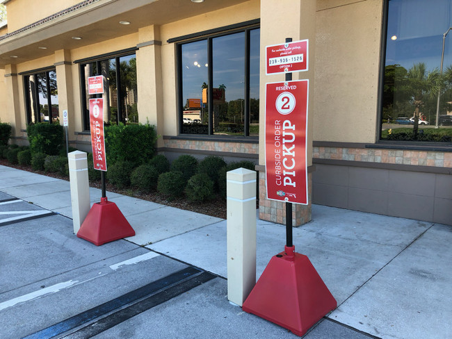 Add Standup Sign Holder Systems that Standout to Your Curbside Pickup