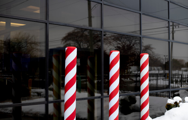 Candy Cane Fabric Bollard Covers Give Businesses and Storefronts a Festive Feel