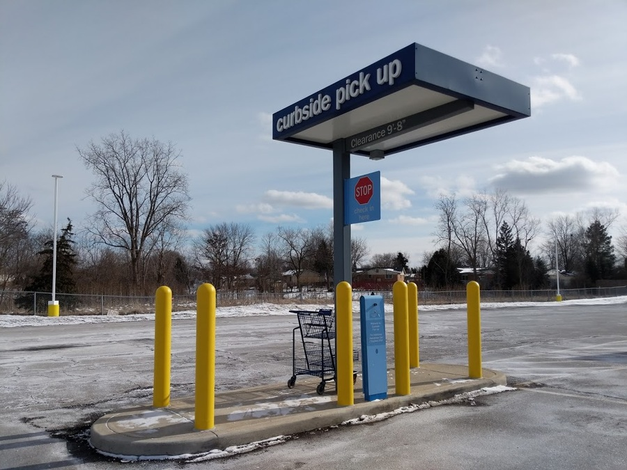 "1/8"" Yellow Bollard Covers at Meijer's Curbside Pickup kiosk"