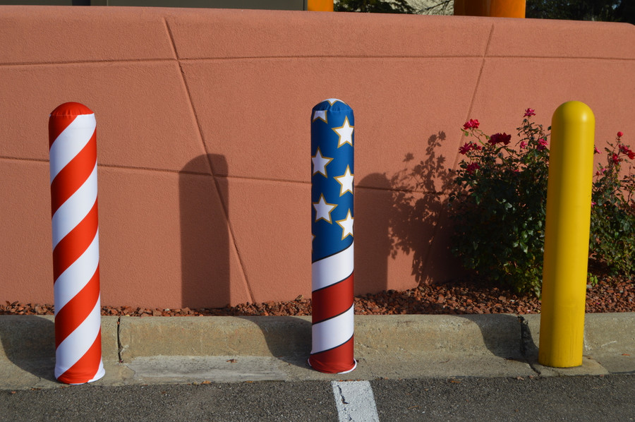 Bollard Company's Fabric Bollard Cover options include Candy Cane and American Flag designs