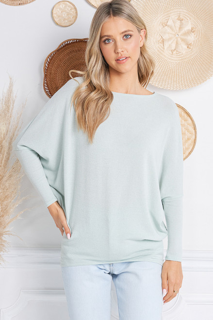 This top has a great fit - always a best seller!  A classic dolman sleeve style with nice length.  Fabric is soft, stretchy, and lightweight .  Made in the USA.