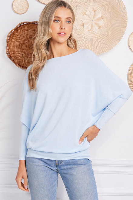 This top has a great fit - always a best seller!  A classic dolman sleeve style with nice length.  Fabric is soft, stretchy, and lightweight.  Made in the USA.