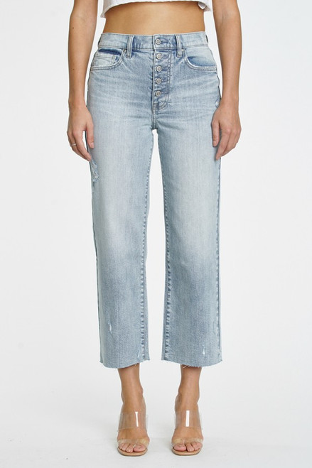 Dawn super high rise wide leg crop in Vibes. Light wash denim with subtle distressing and fading. Five-pocket design, belt loops and exposed front button closure. This fit features an 11 in. high rise and 26 in. inseam. Manufactured in an Eco-friendly wash.