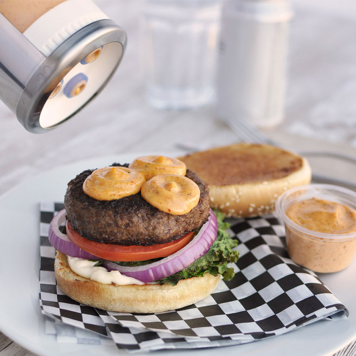 Sauce Gun Bottle's three valve dispensing cap provides great coverage for burgers and sandwiches