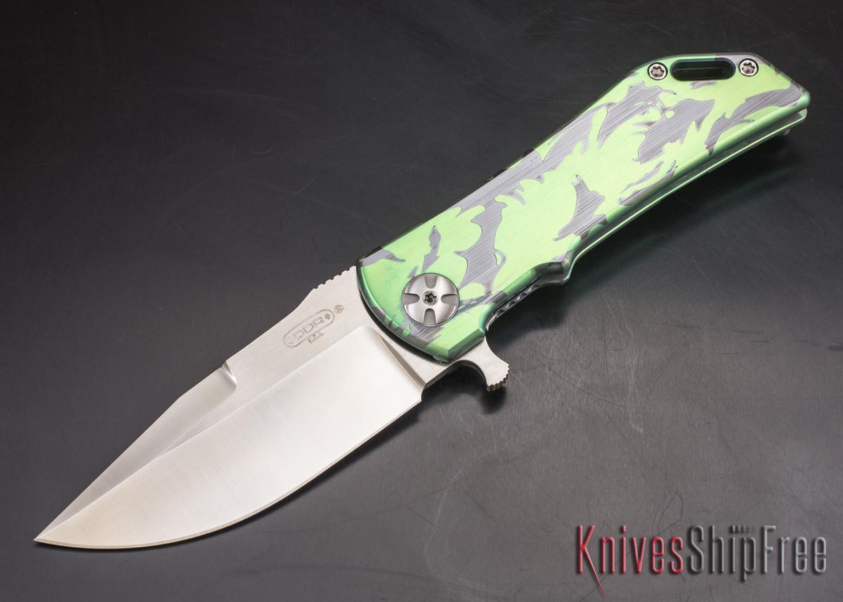 Darrel Ralph - DDR Knives: Dominator 3.5 - CPM-S35VN - Titanium Framlock - ITR Green Camo - Clip Point primary image