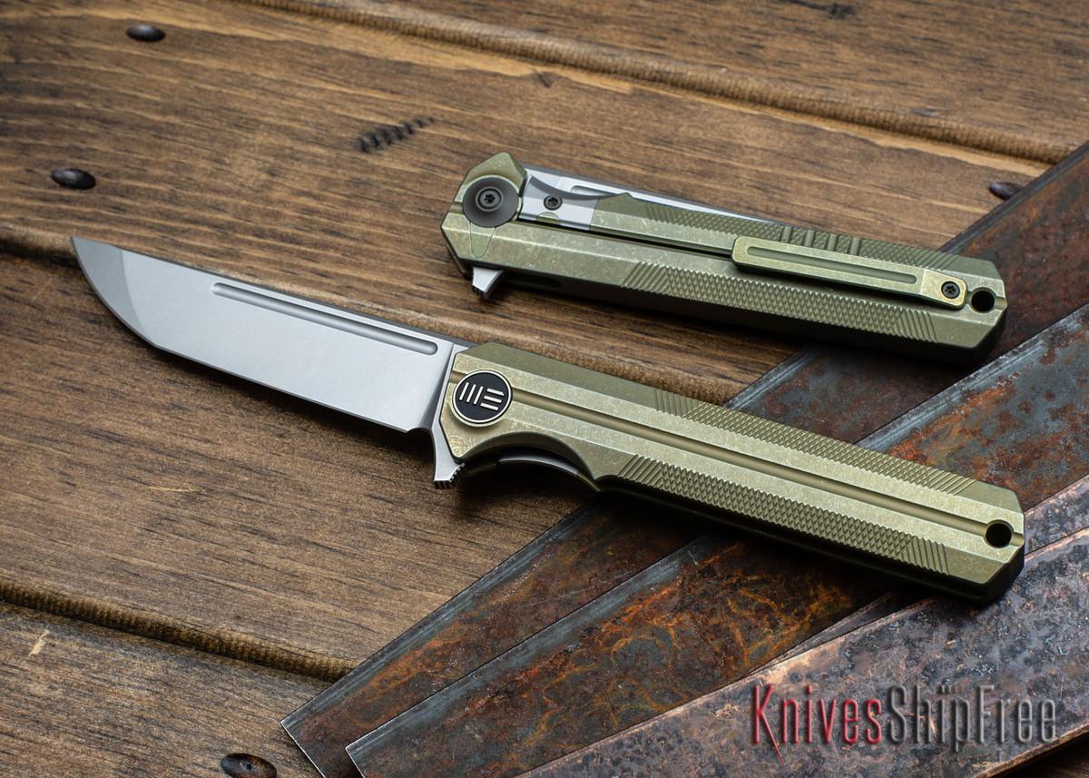WE Knife: 909B Syncro - Golden Titanium Framelock - One Piece Integral Frame - CPM S35VN - Stonewash primary image