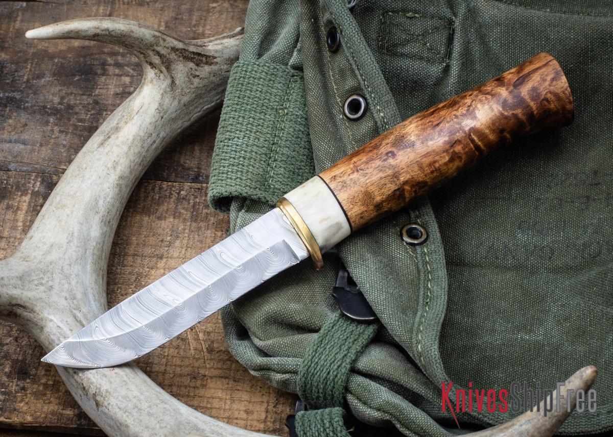 Karesuando: Bäver Damask - Damasteel Hunting Knife - Dark Curly Birch 02 primary image